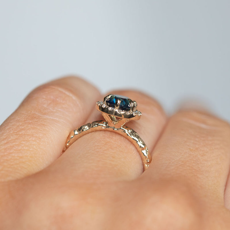 1.63ct Oval Deep Blue Unheated Sapphire and Diamond Six Prong  Halo Evergreen Ring in 14k Yellow Gold