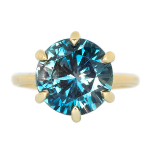 6.84ct GIA Round Montana Sapphire Six Prong Split Shank Solitaire in 18k Yellow Gold