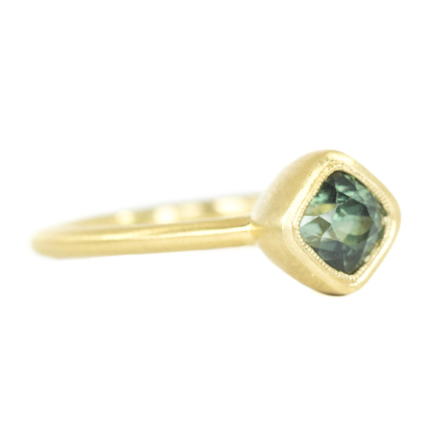1.56ct Cushion Cut Sapphire With Milgrain Bezel Set In 18k Yellow Gold Brushed Finish