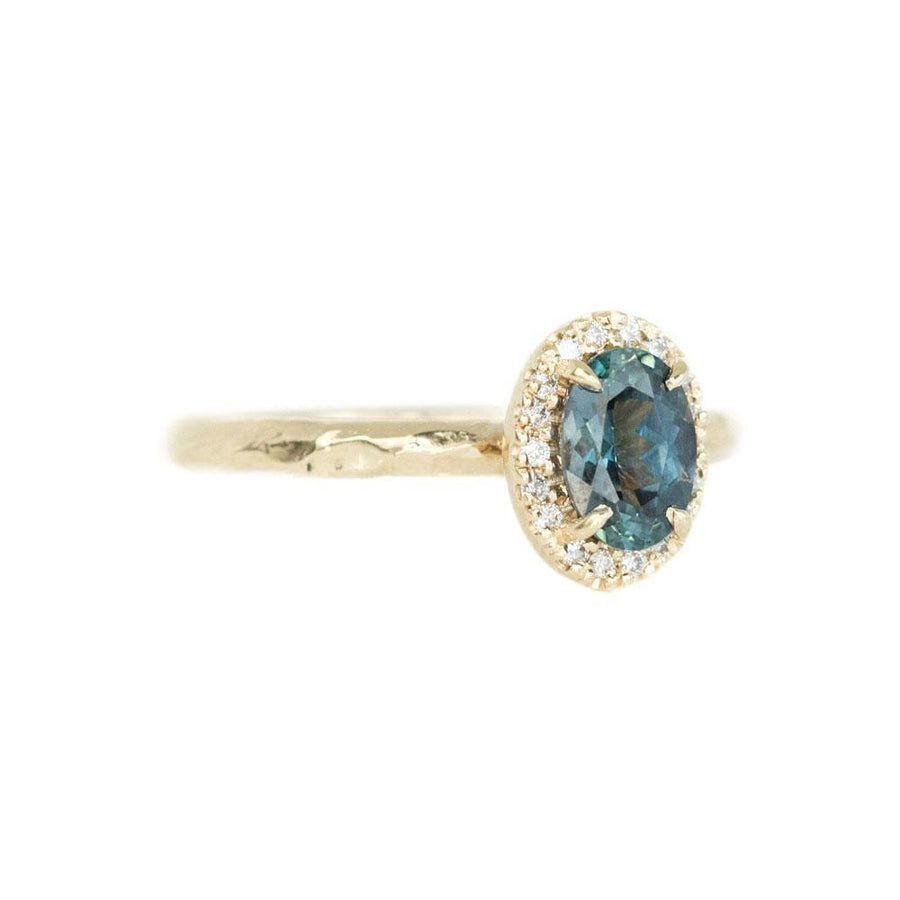 1.04ct Blue Montana Sapphire in 14k Yellow Gold Evergreen Diamond Halo