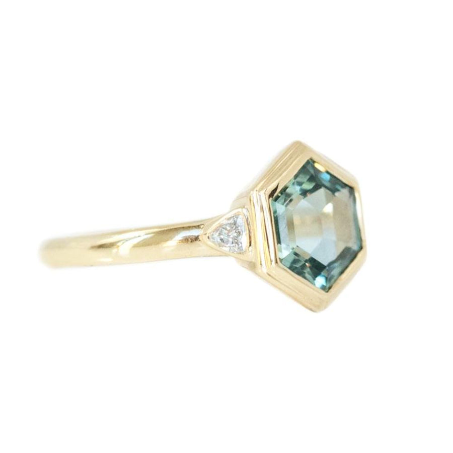2.61ct Montana Sapphire Hexagon Ring Bezel Set with Trillion side diamonds in yellow gold