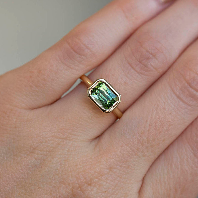 1.41ct Radiant Cut Green Tourmaline East-West Bezel Set In 14k Yellow Gold