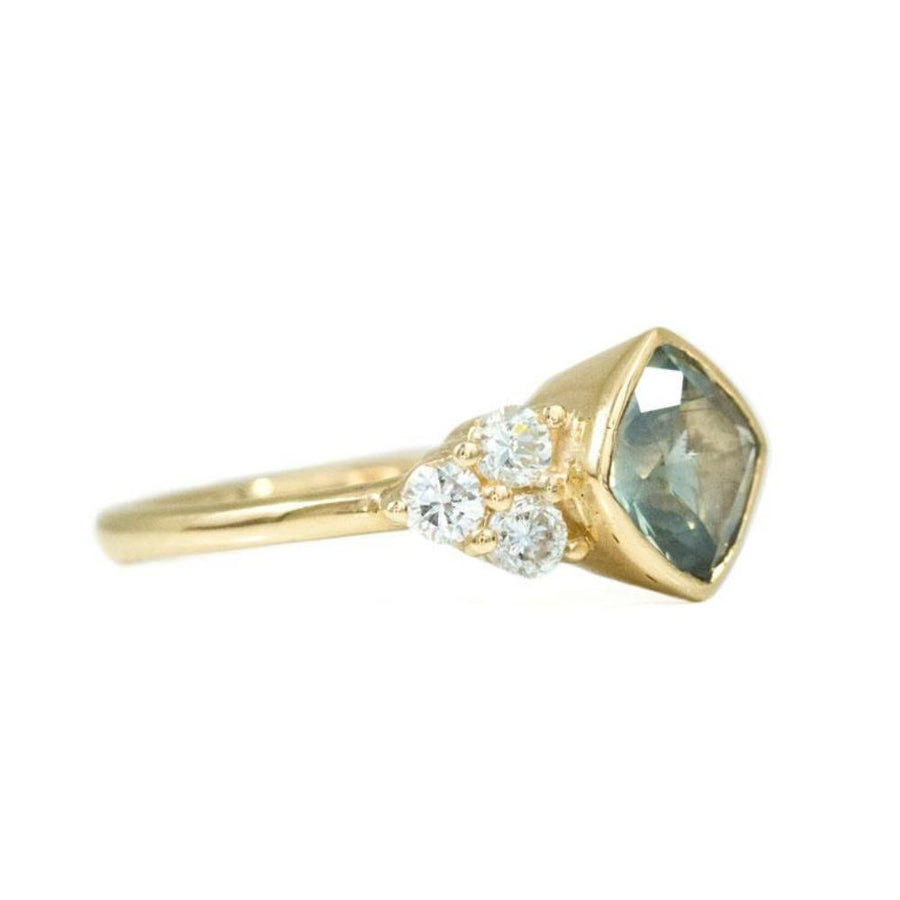 Minty Cushion Cut Sapphire Ring with Diamond Cluster Side Stones in Bezel Yellow Gold