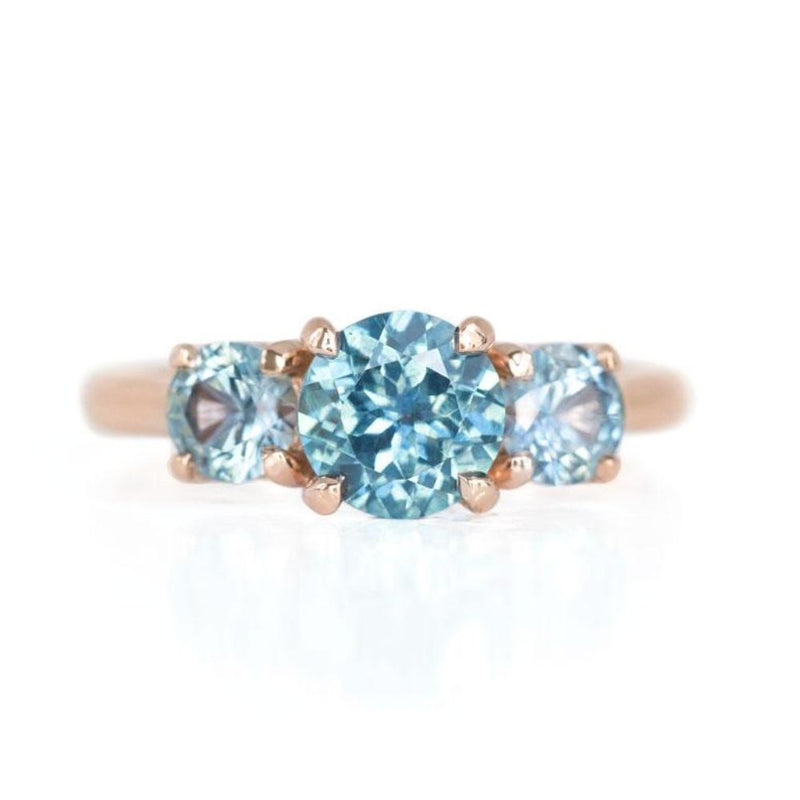 Three Stone Montana Sapphire Ring with 1.27ct Blue Center in 14k Rose Gold