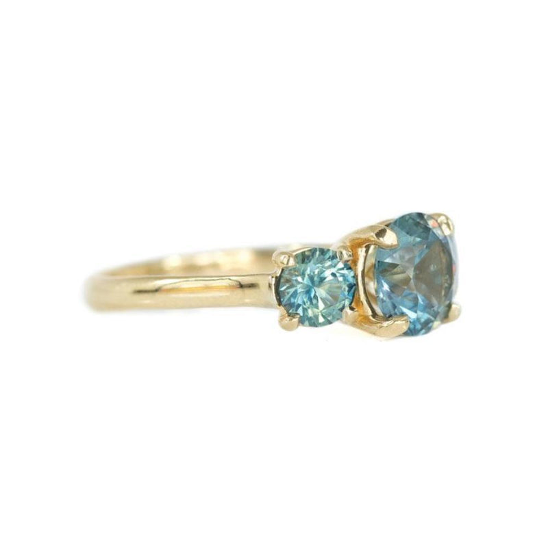 Three Stone Montana Sapphire Ring with 2.10ct Teal Color-Changing Center Stone in 14k Yellow Gold