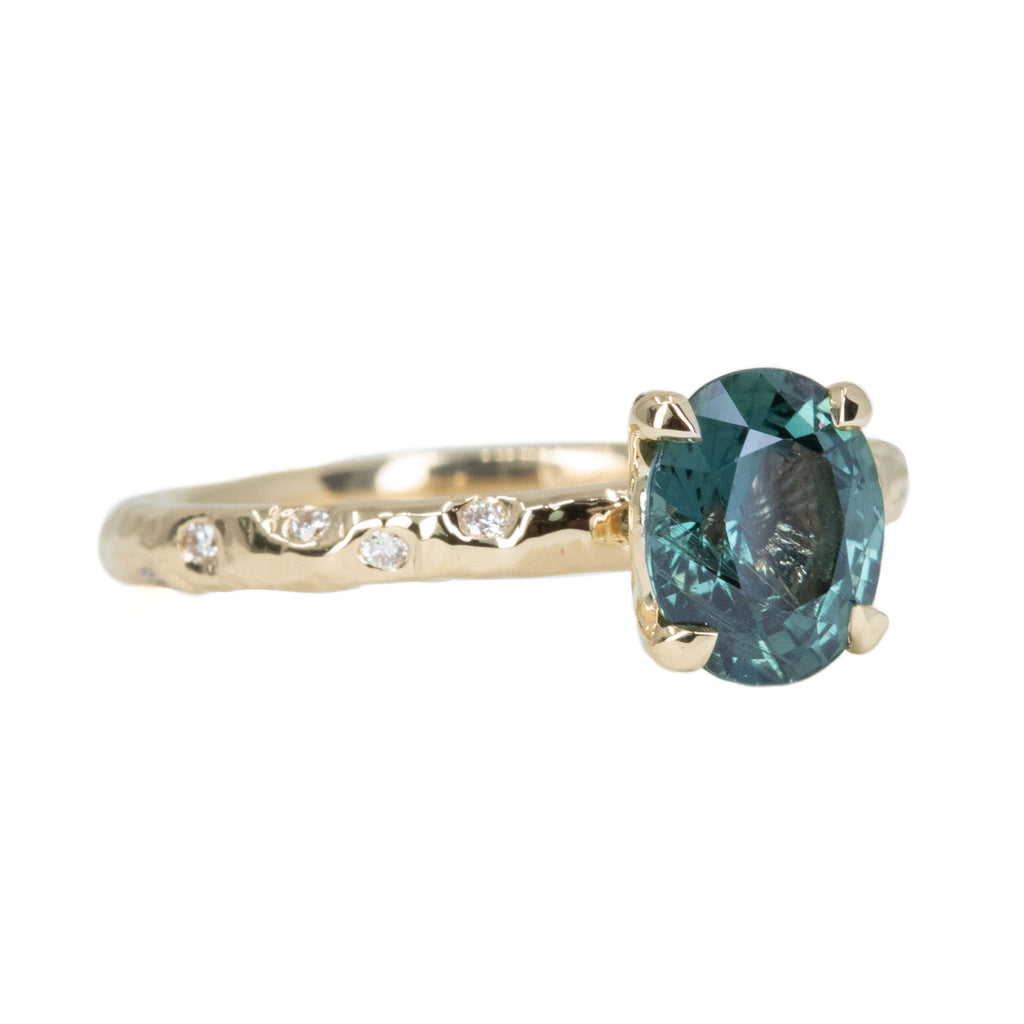 1.79ct Oval Blue Color Changing Sapphire in 14k Yellow Gold Evergreen Solitaire with Scattered Embedded Diamonds