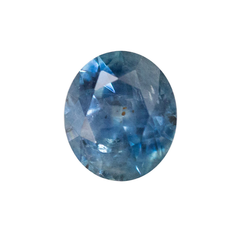 1.60CT ROVAL/ROUNDED OVAL MEDIUM OCEAN BLUE MONTANA SAPPHIRE WITH EARTHY AND SILK INCLUSIONS, 7.5X6.5MM