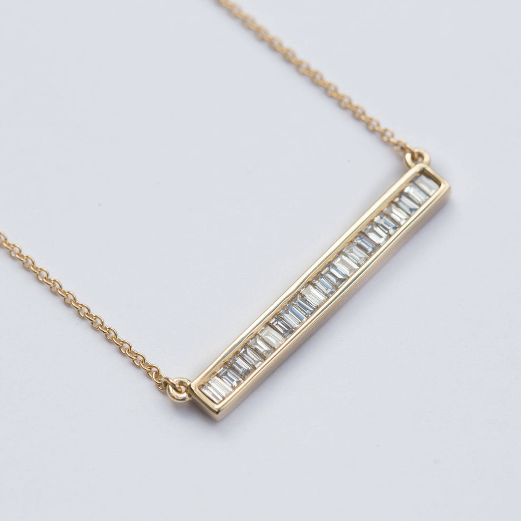 baguette bar channel set diamond pendant yellow rose gold conflict free diamond necklace