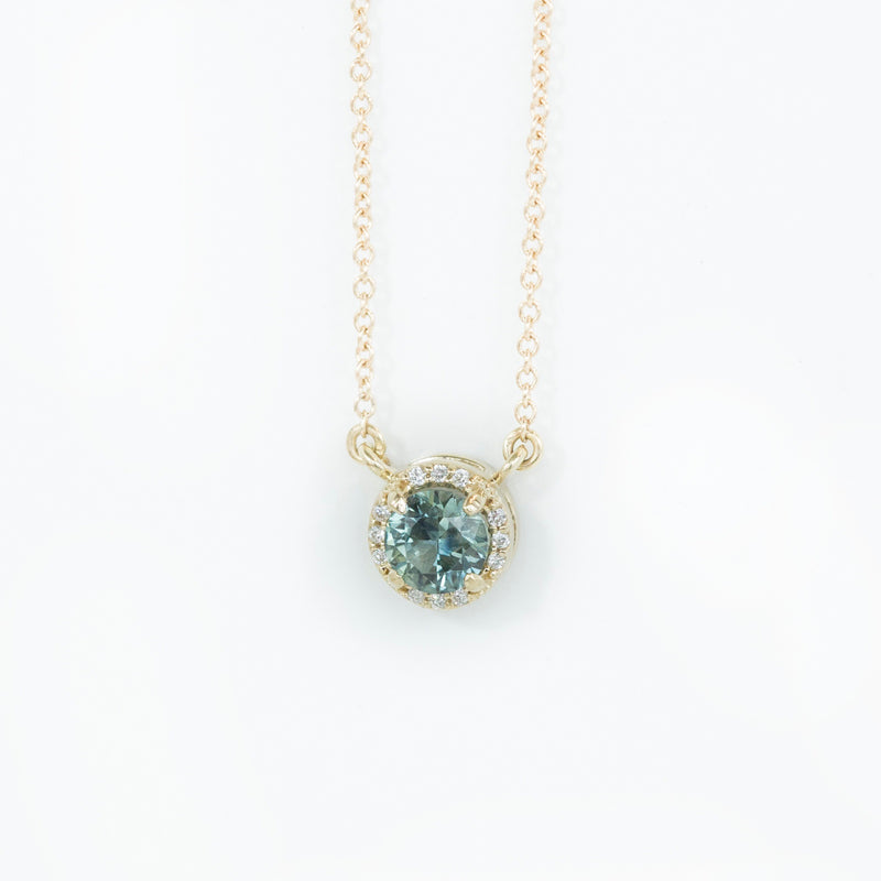 Madagascar Sapphire and diamond halo necklace in 14k gold