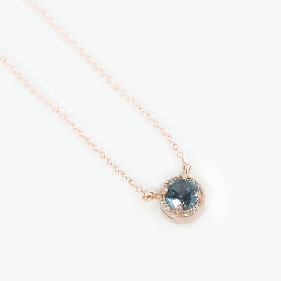 0.52ct Montana Sapphire and diamond halo necklace in 14k rose gold