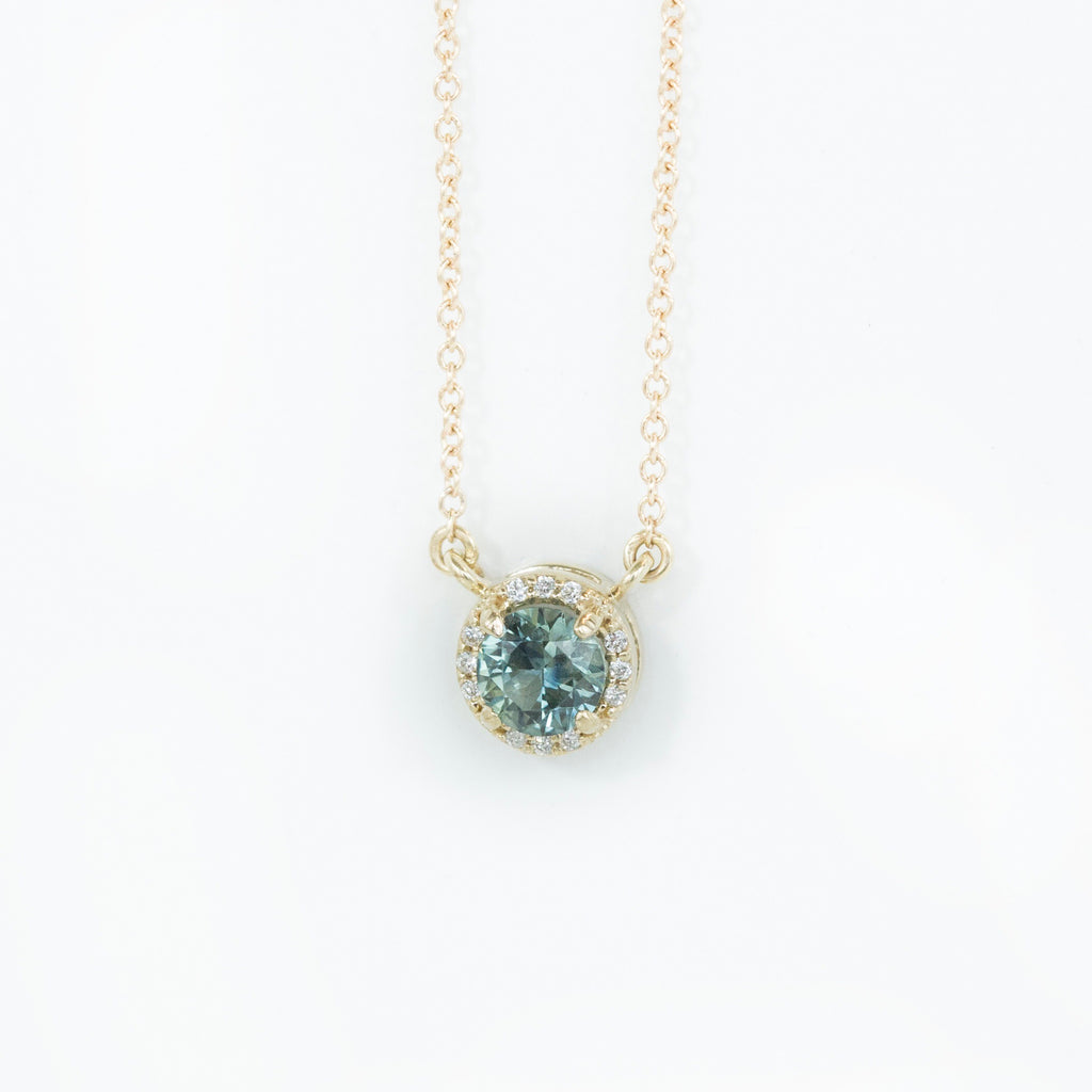 0.56ct Montana Sapphire and diamond halo necklace in 14k yellow