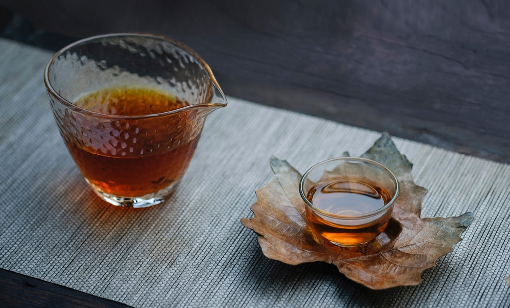 fall orange herbal tea in small glasses