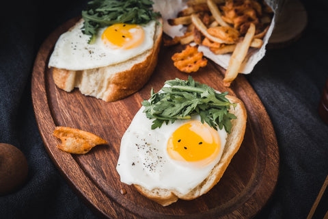 Sunny-side up eggs on toast with lettuce