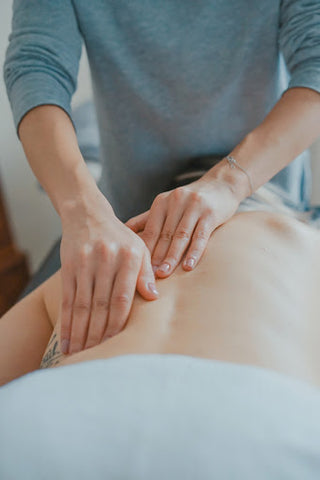 hands massage a bare back
