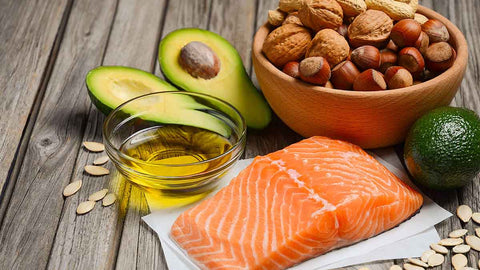 selection of healthy fats and oils avocado salmon nuts