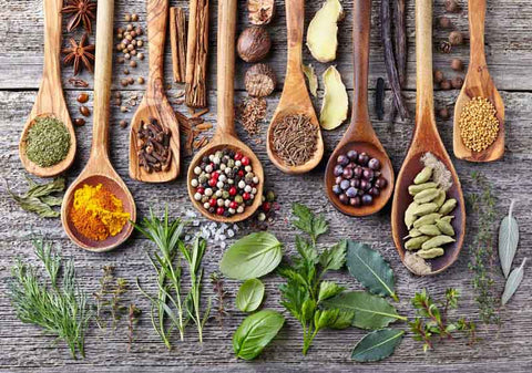 different herbs and spices flatlay in spoons