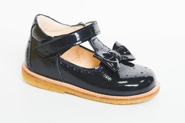 Angulus navy patent tbar shoe with bow detail