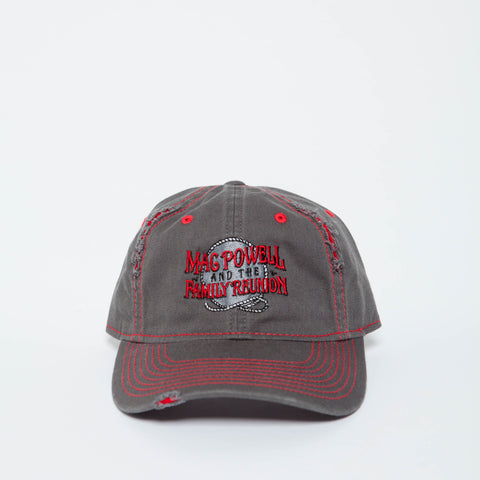A Mac Powell distressed gray and red hat.