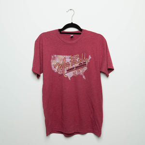 "A red Mac Powell t-shirt that reads ""Mac Powell and the Family Reunion"" and has a design of a map of the united states."