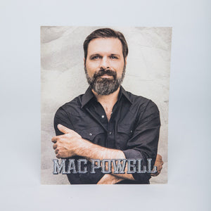 8x10 poster of a portrait Mac Powell crossing his arms.