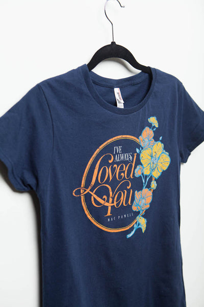 "Close up of a navy blue ladies Mac Powell tee that reads ""I've Always Loved You - Mac Powell."""