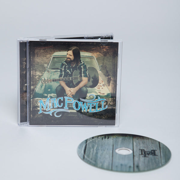 Mac Powell self titled album with a photo of Mac sitting on a chevy car with a guitar displayed with the CD.