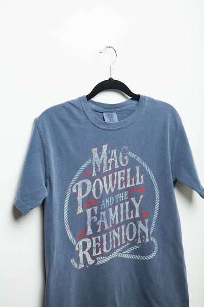 Side view of a blue t-shirt that reads Mac Powell and the Family Reunion within a lasso design.