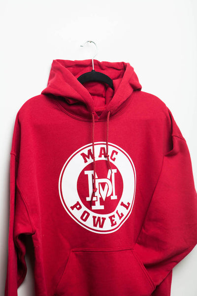Close up of a red Mac Powell hoodie sweatshirt that has the MP logo in the center.