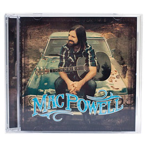Mac Powell self titled album with a photo of Mac sitting on a chevy car with a guitar.