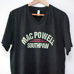 A black v-neck t-shirt that reads Mac Powell Southpaw on the front.
