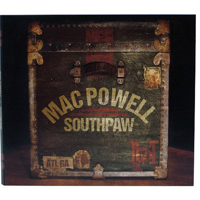 Mac Powell Southpaw CD that has a photo of a vintage chest on the cover.
