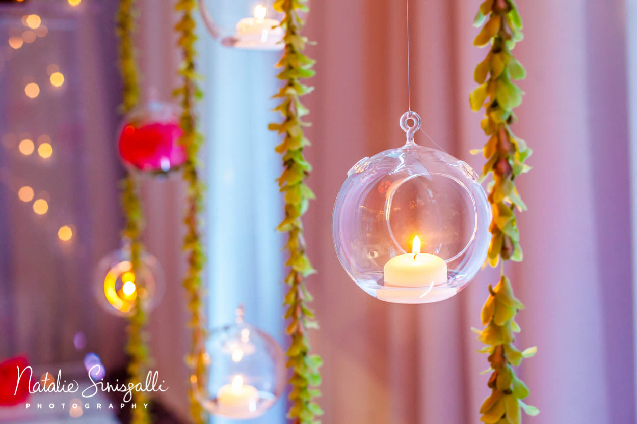 Coral Teal and Silver Wedding with hanging strung orchids and candle orbs