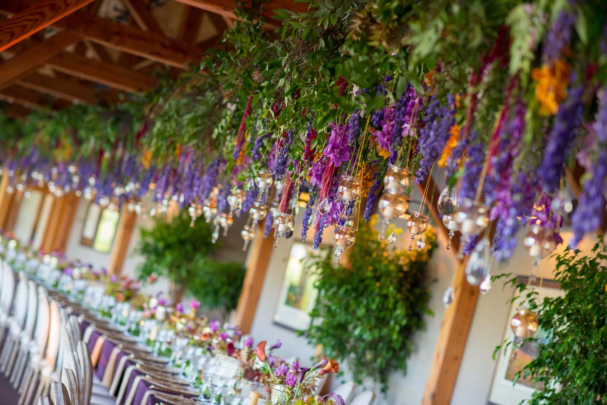 hanging floral installation with purple flowers
