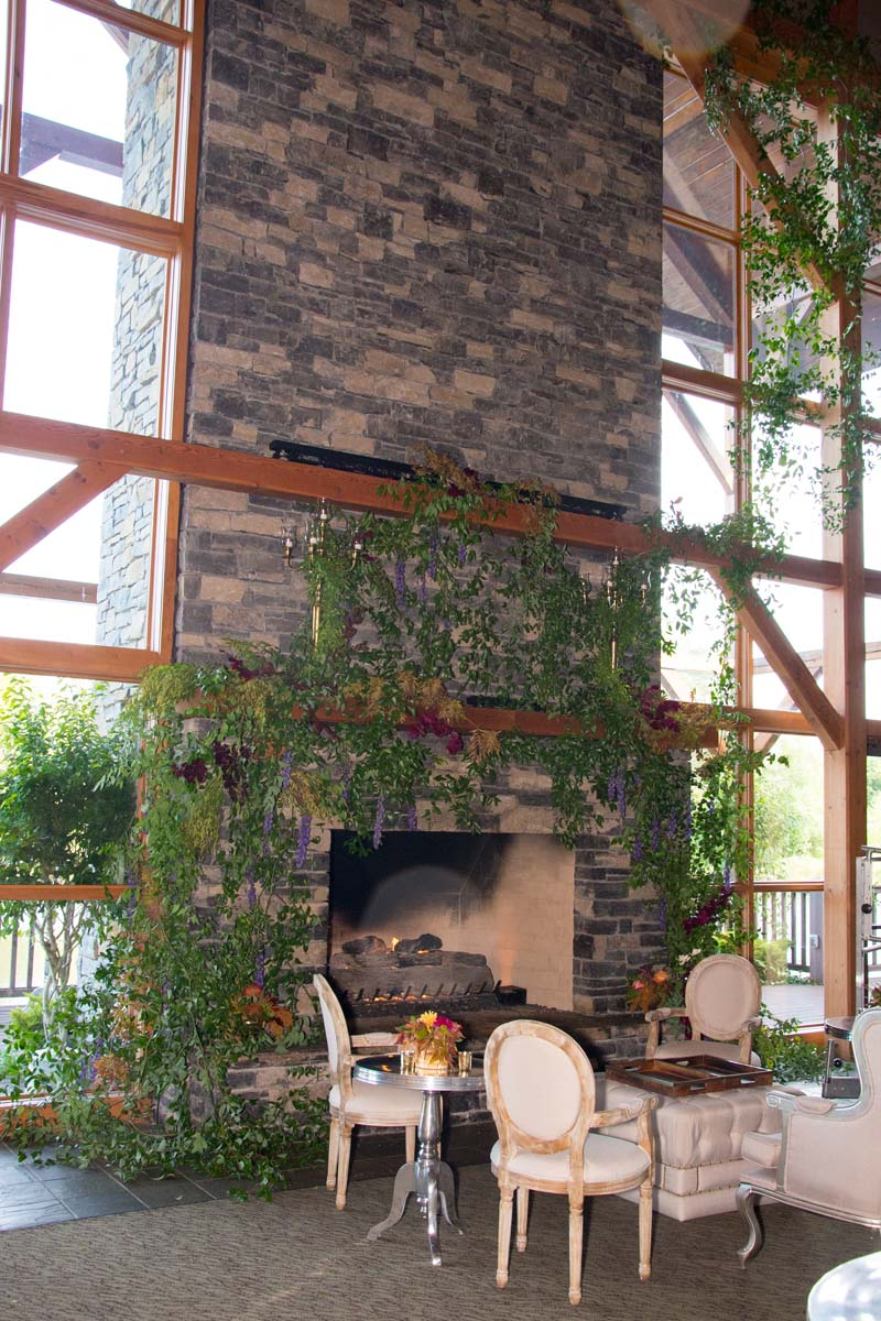 fireplace with green vines at lodge at welch allyn