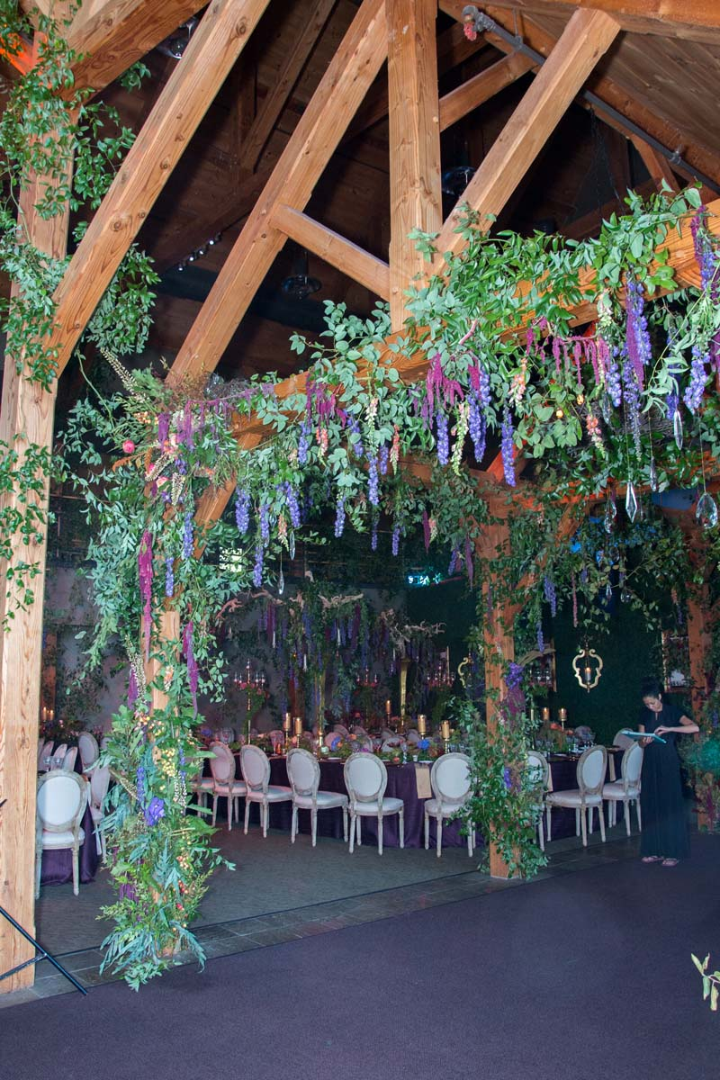 floral covered structure in wedding