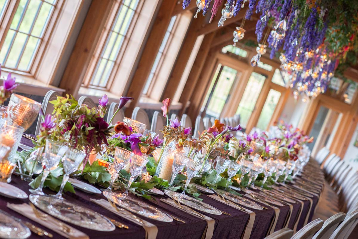 one long centerpiece table with hanging floral