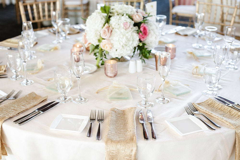 white blush and gold centerpiece