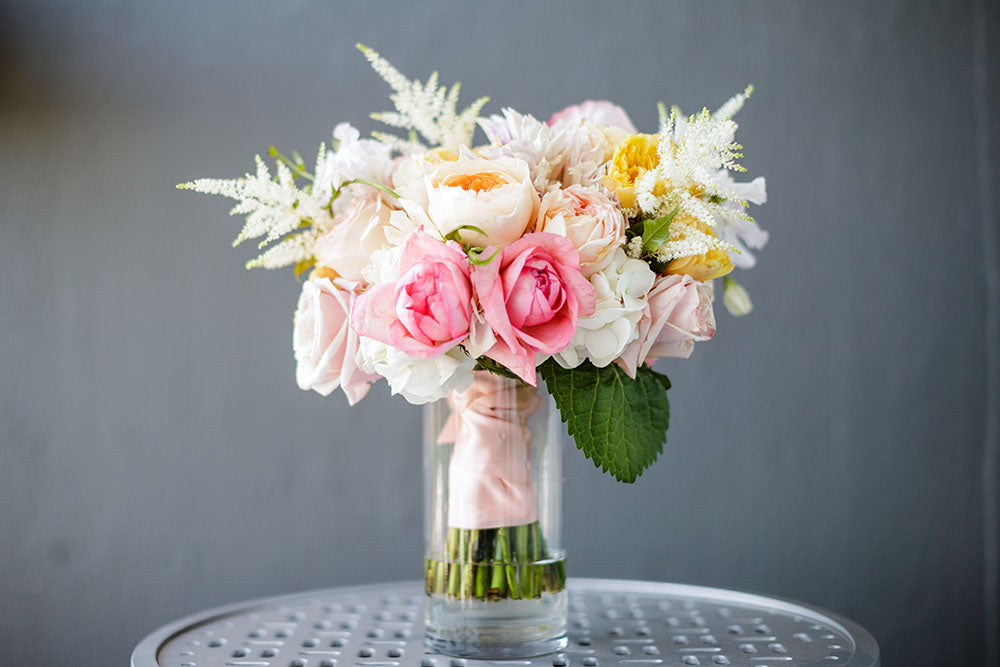 sherbet tone wedding bouquet with garden roses
