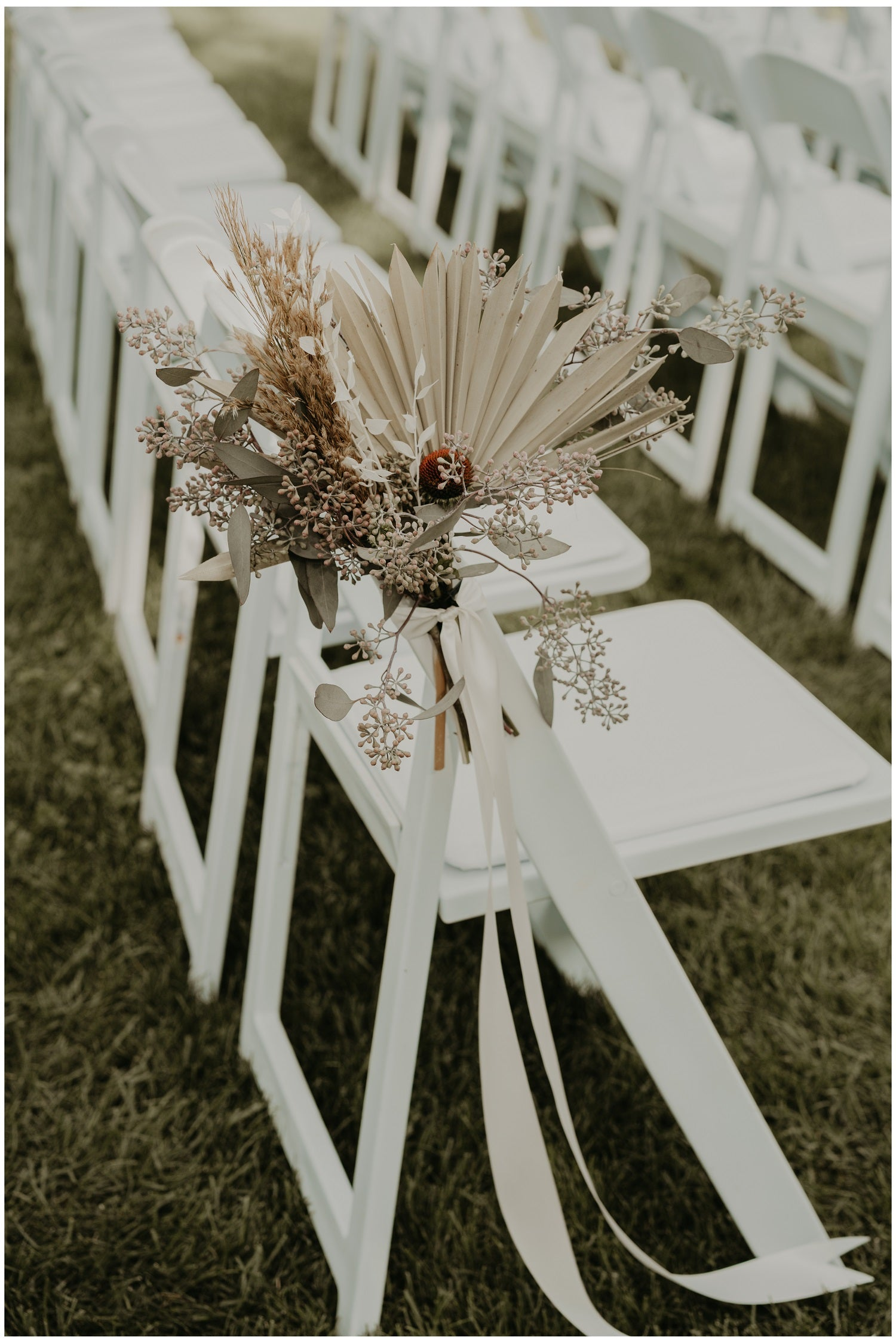 Dried palm fan wedding aisle chair bouquets