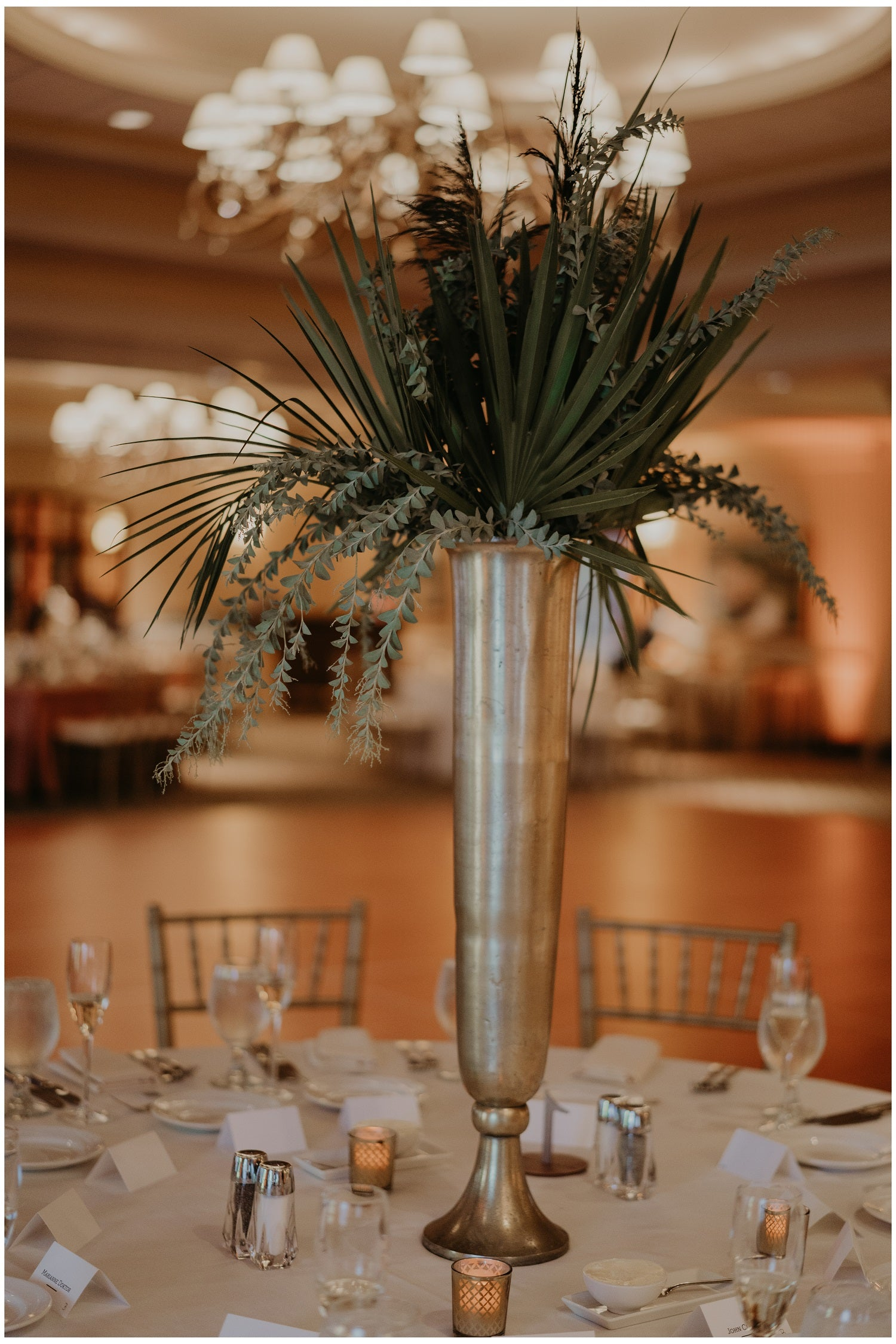 Tall all green centerpiece in gold vase