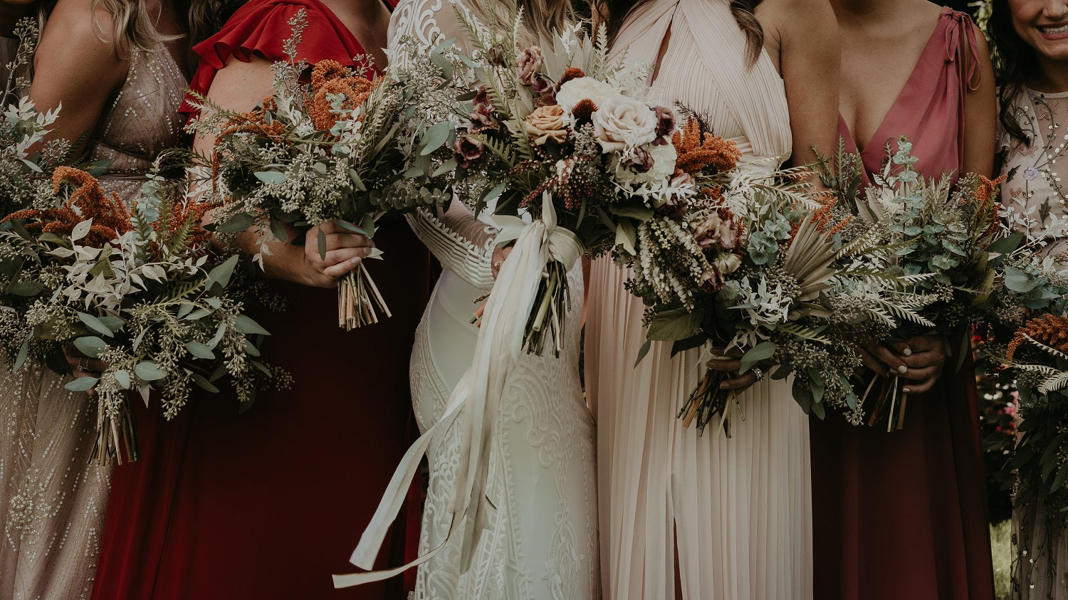Dried and fresh flower boho bouquet with bridal party in rust dress