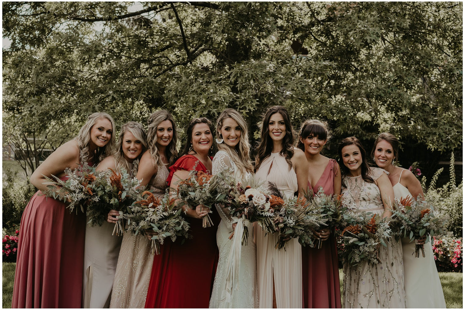 rust, taupe, and ivory wedding party with boho bouquets