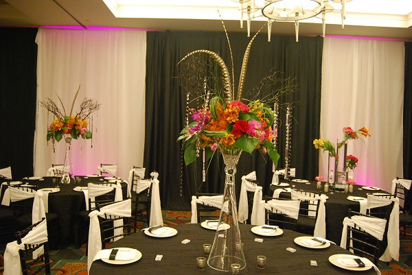 tall pink and orange centerpiece with feathers