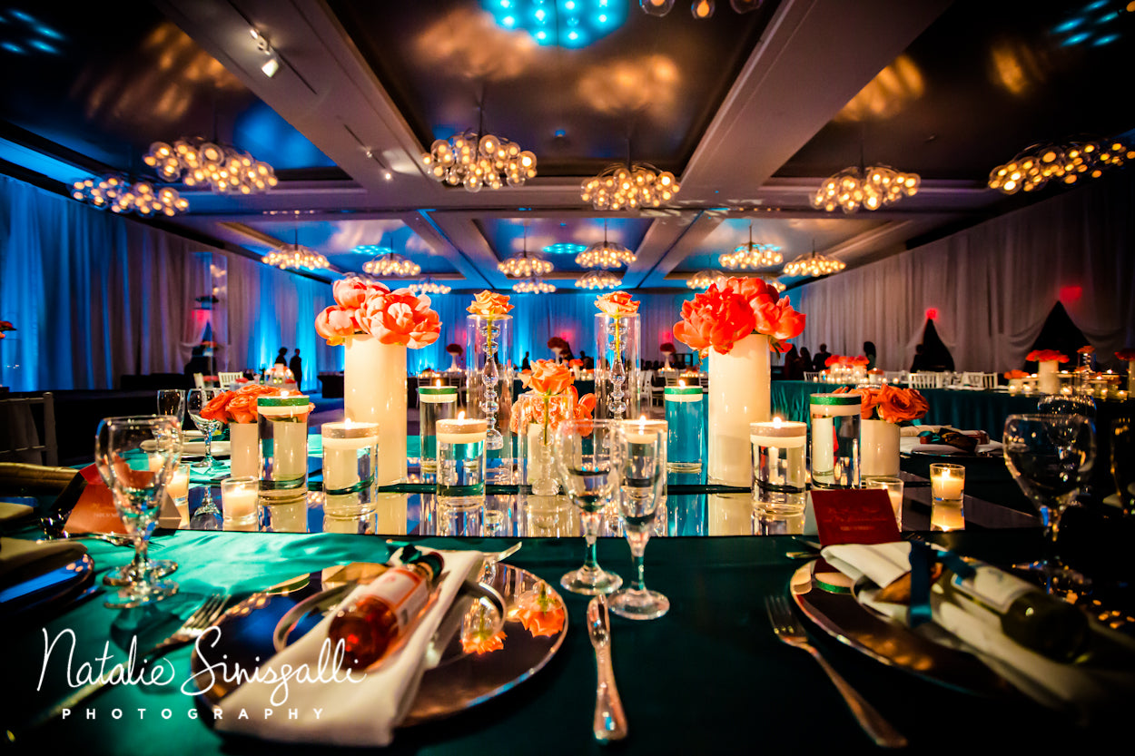 Room shot of coral and teal wedding by Stacy K floral photographed by Natalie Sinisgalli
