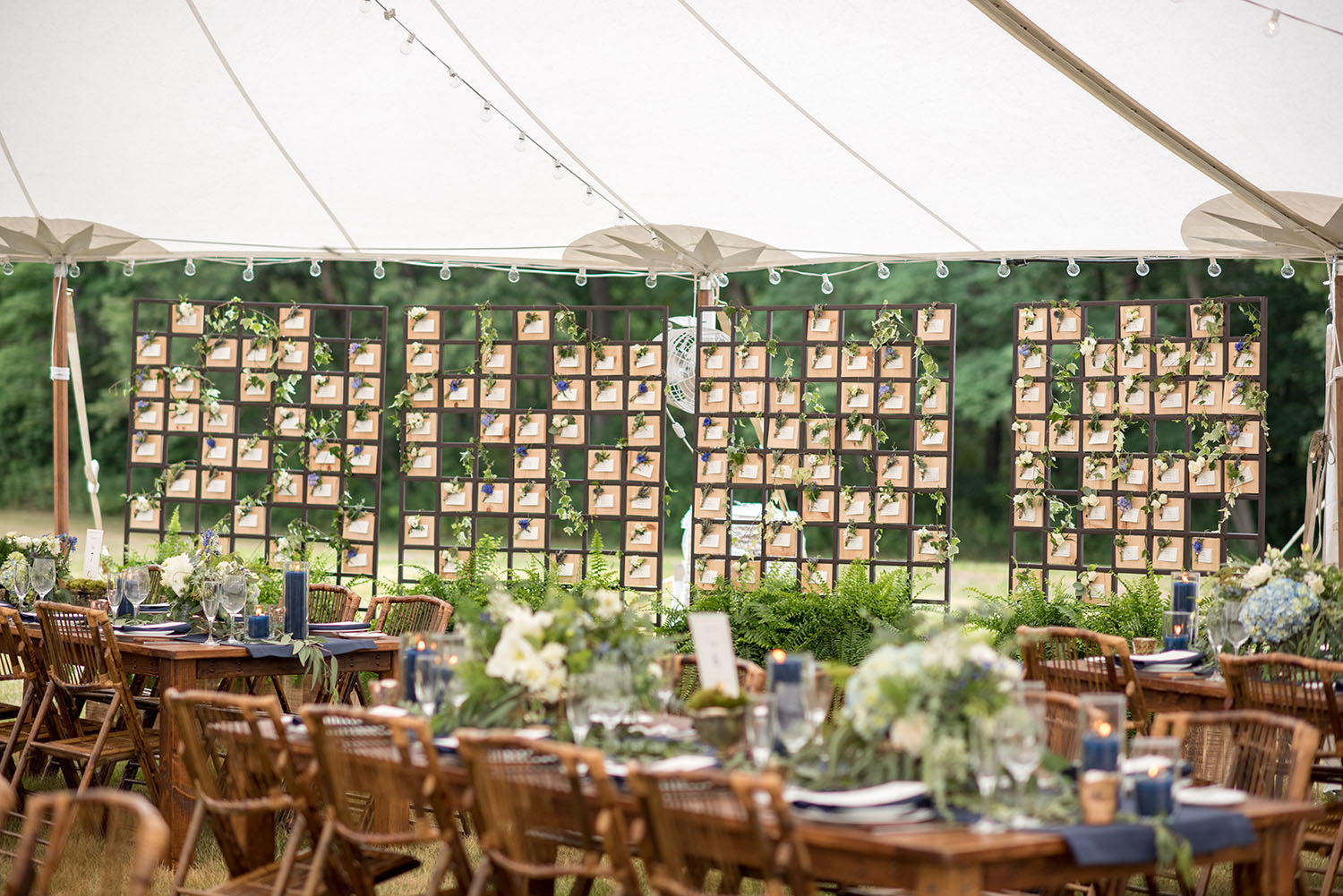 place card wall with individual boutonnieres