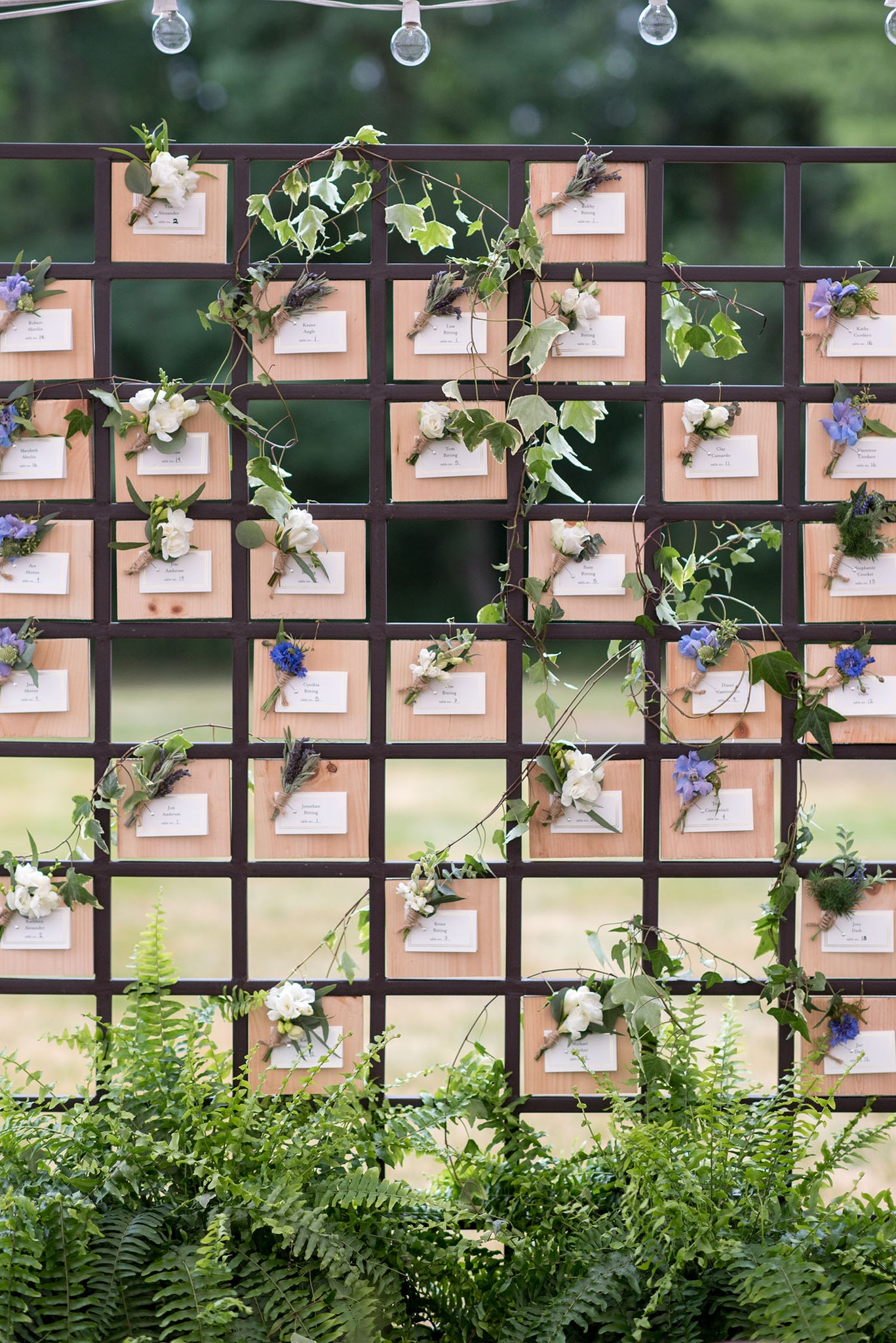 Individual boutonniere place card wall