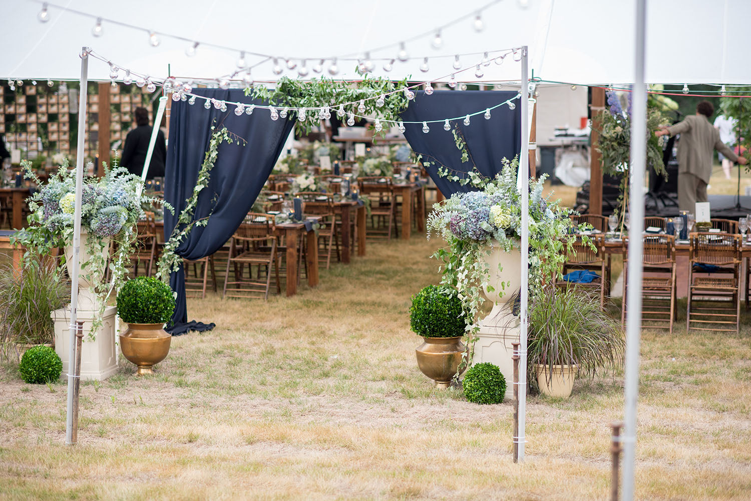 tent entry draped in blue fabric