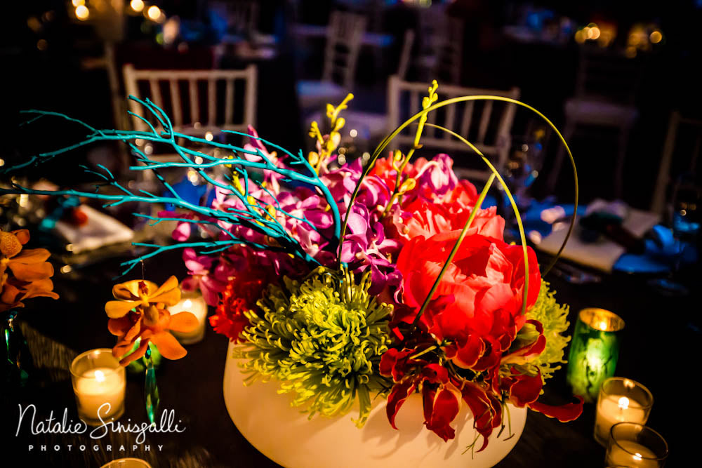 Low centerpiece in coral, teal,lime green  with orchids and peoniesby Stacy K Floral