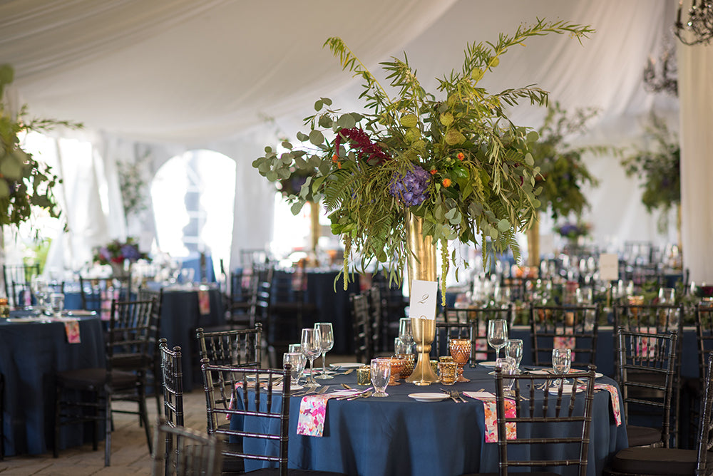 navy wedding linens with colorful napkins and flowers