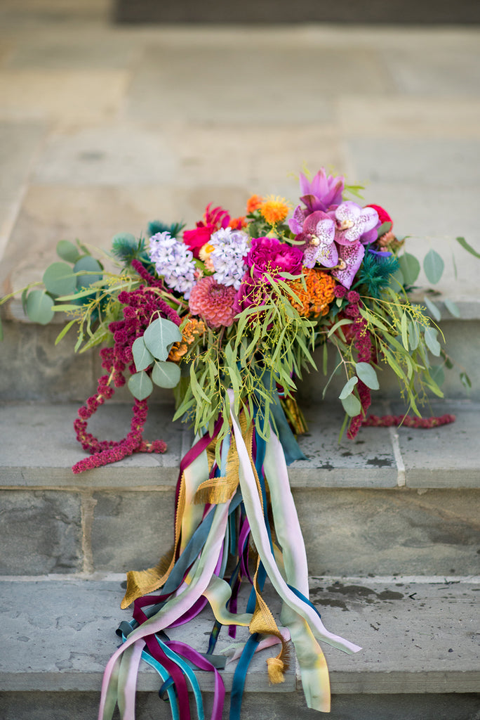 colorful bridal bouquet with trailing ribbons